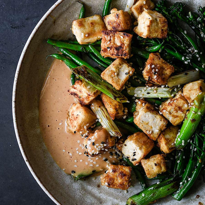 Crispy tofu, peanut sauce & sesame greens